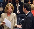 Debbie Mayfield and John Legg confer on the House floor.jpg