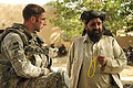 Defense.gov News Photo 100907-F-8920C-005 - U.S. Army Capt. Maxwell Pappas left district support unit leader of the Zabul Provincial Reconstruction Team speaks with Shah Joy district Chief.jpg