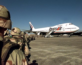 Tower Air - US Army soldiers line up to board a Tower Air charter flight from Hunter AAF during Operation Southern Watch in 1998.