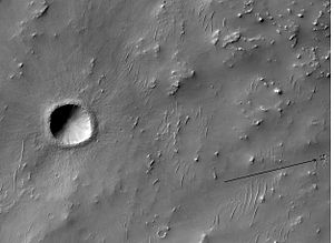 Denning (Martian crater) - Recent small crater on floor of Dennin Crater, as seen by HiRISE.  Arrow shows group of secondary craters from ejecta falling down.