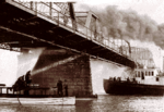 Detroit fireboats try to extinguish the burning Belle Island Bridge, 1915.png