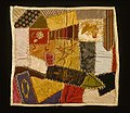 Doll Size Crazy Quilt With Embroidered Bird At Center.jpg