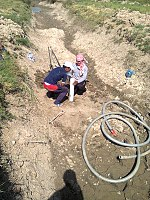 Drilling a hand dug well inside the river 06.jpg