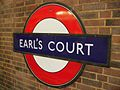 Earl's Court stn District roundel.JPG
