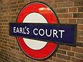 Earl's Court stn District roundel.JPG