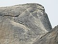 East end of Half Dome, telephoto view of cables. Yes, the little black specks are people. - panoramio.jpg