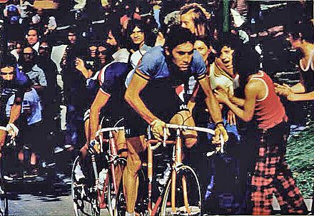With his victory in the men's road race at the 1974 UCI Road World Championships and his victories in two Grand Tours, the Giro and Tour, Merckx became the first rider to win the Triple Crown of Cycling. Eddy Merckx Canada 1974 WK.jpg