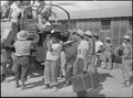Eden, Idaho. Baggage, belonging to evacuees from the assembly center at Puyallup, Washington, is so . . . - NARA - 538279.tif