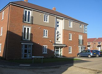 Medium-density housing - A medium-density development, in the United Kingdom. Typical features are the apartments in a multi-storey (but not high-rise) building.