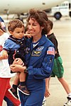 Ellen Ochoa carries her son Wilson.jpg