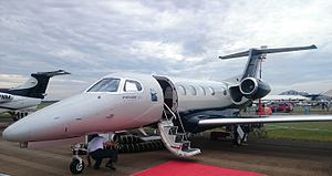 Embraer Phenom 300 - Phenom 300 on ramp, entry door open