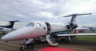 Embraer Phenom 300 - Phenom 300 on ramp, entry door open