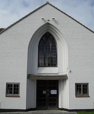 St Mary's Church, Hampden Park, Eastbourne - The entrance is set in a deeply recessed pointed arch.