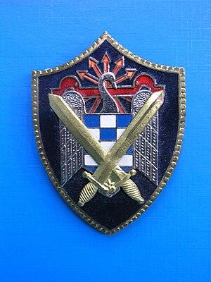 Falange Española de las JONS - Image: Escudo de las Milicias Universitarias