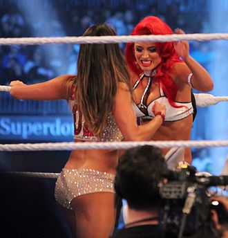Eva Marie - Marie wrestling Nikki Bella (front) at the WrestleMania XXX event in April 2014