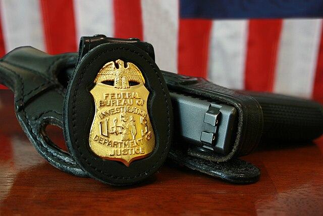 From commons.wikimedia.org: FBI Badge & gun {MID-73044}