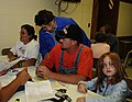 FEMA - 35665 - SBA helping residents at a Disaster Recovery Center.jpg
