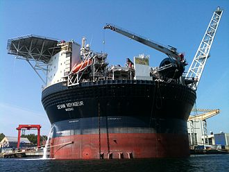 Floating production storage and offloading - The circular FPSO Sevan Voyageur moored at Nymo yard at Eydehavn, Norway