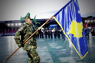 Kosovo Security Force - A member of FSK with Kosovo's flag at a military parade in the Netherlands