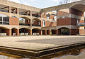 Falmer House inner courtyard showing arches, building levels and divisions and part of inner moat, University of Sussex.jpg