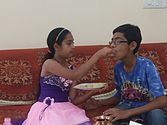 Feeding Sweets by hand on the ocassion of Raksha Bandhan.jpg