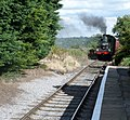 Finghall Lane railway station & approaching train, view east to Bedale, Wensleydale Railway, Yorkshire.jpg