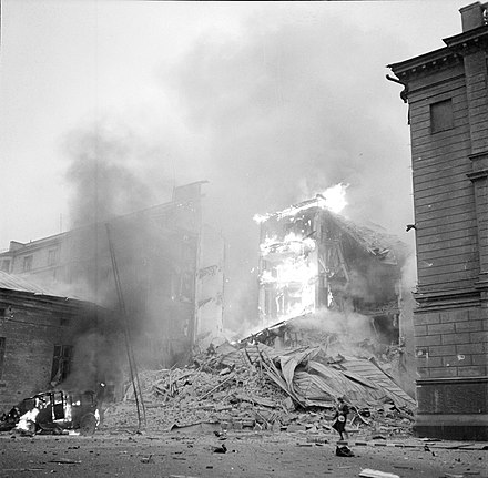 Fire at the corner of Lonnrotinkatu and Abrahaminkatu streets in Helsinki after Soviet aerial bombing of Helsinki on 30 November 1939 Fire at the corner of Lonnrot and Abraham Streets.jpg
