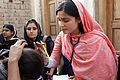 Flickr - DFID - A female doctor with the International Medical Corps examines a woman patient at a mobile health clinic in Pakistan.jpg
