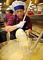 Flickr - Official U.S. Navy Imagery - Staff member at Navy galley measure batter to use on griddle..jpg