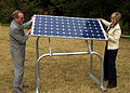 Fowler and Governor installing solar panel.jpg