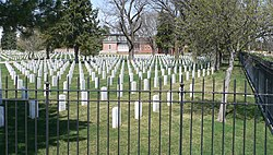 Ft. McPherson National Cemetery headstones and lodge 2.jpg