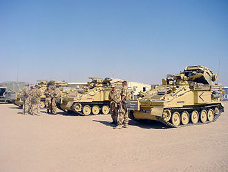 Combat Vehicle Reconnaissance (Tracked) - Three Strikers in desert colours, the vehicle nearest the camera has its missile launchers raised
