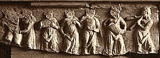 Aulos - An aulos flute (right) and other instruments appear in this Hellenistic frieze from Jamal Garhi in Gandhara.