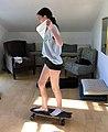 Girl skateboarding in house with white flag.jpg
