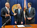 Governor Rick Scott, center, with legislators signing bill into law during the legislative session.jpg