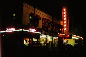 Mirth, Marvel and Maud - The building in its incarnation as the Granada - lit up with neon signs