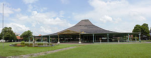 Joglo - An immense royal pendopo in Mangkunegaran Palace shows joglo roof after being extended outward multiple times.