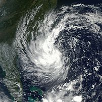 Tropical Storm Gustav is hovering off the coast of Georgia and the Carolinas in this true-color Moderate Resolution Imaging Spectroradiometer (MODIS) image from September 9, 2002. The image was acquired by the MODIS instrument on the Aqua satellite. Gustav kicked up heavy surf along the North Carolina coast and brought heavy rains to the region, but did not make landfall. Instead, the storm began to track northeast on September 10 and 11. With maximum sustained winds up to 70 miles per hour, it was still possible that Gustav might reach Category 1 hurricane status before moving northward into cooler waters that will cause the storm to weaken. Strike trajectories from Wednesday morning, September 11, indicate the storm could make landfall near Maine, New Brunswick, and Nova Scotia in about 24 hours.