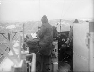 HMS Bellona (63) - A Force 12 plus gale was blowing when this picture was taken from the bridge as HMS Bellona plunged through mountainous seas on a convoy to Russia. Note the huge wave in front of the ship