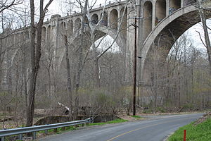 Blairstown Railway - The Blairstown Railway ran adjacent to the opposite side of Station Road in Hainesburg, New Jersey, under the easternmost arch of the Paulins Kill Viaduct on the Lackawanna Cut-Off, as shown in this April 2011 photo.  There was no connecting track between the Blairstown Railway and the Lackawanna Cut-Off.  Hainesburg Station, on what was the New York, Susquehanna & Western Railroad, was located directly under the viaduct.  The remains of the freight station's foundation can clearly be seen in the left-center of the photo.  The tracks on the Blairstown Railway were removed from this location in 1963.