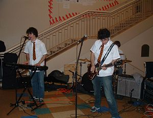 Harry Potter (character) - Harry and the Potters perform at the Horace Mann School in Riverdale, Bronx, New York. Note the artists' black hair and spectacles.