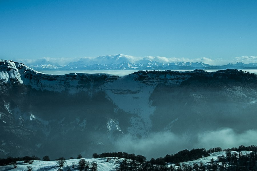 The Haute Chaîne du Jura, from the Crêt de Chalam, Ain. Lake Geneva and the Alps are at the back, with Mont-Blanc, right in the middle.