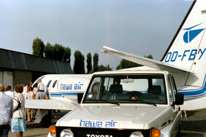 Hawa Air - A photo of one of Hawa Air's Cessna's Citation Jets and one of Hawa Air's company cars during a public fair.