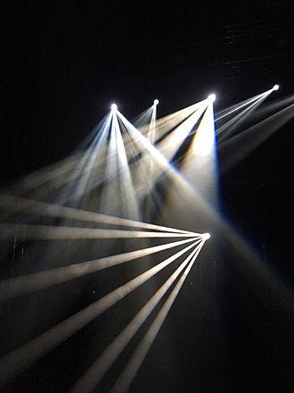 Light beam - Beams shining through water-based haze in a photo studio setting.