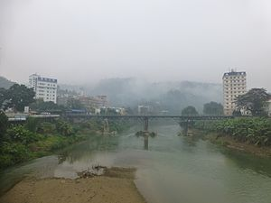 Kunming–Hai Phong Railway - The Kunming–Hai Phong Railway crossing the Nanxi River from Lao Cai, Vietnam (on the right) to Hekou, China (on the left)