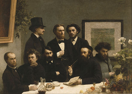 Henri Fantin-Latour, By the Table, 1872, depicting: Paul Verlaine, Arthur Rimbaud, Leon Valade, Ernest d'Hervilly and Camille Pelletan (seated); Pierre Elzear, Emile Blemont and Jean Aicard (standing) Henri Fantin-Latour - By the Table - Google Art Project.jpg