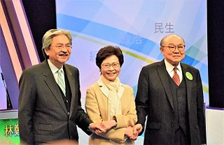 這次選舉基本上是大局已定——約六成民意支持的曾俊華,在這扭曲的選舉制度下,幾乎可以肯定將不敵僅得約三成民意支持的林鄭月娥。 (圖片:VOA@Wikimedia)