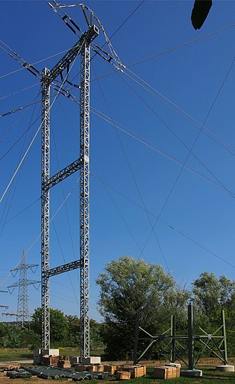 Transmission tower - Temporary guyed pylon next to a commenced new tower