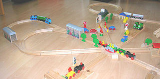 Wooden toy train toy train running on wooden railroad tracks