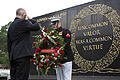 Honorary Marine Daran Wankum, left, salutes as a Marine lance corporal places a wreath during a wreath laying ceremony at the Marine Corps War Memorial in Arlington, Va, June 13, 2013 130613-M-KS211-006.jpg
